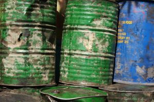 blue and green rusty barrels with chemical resistant coating
